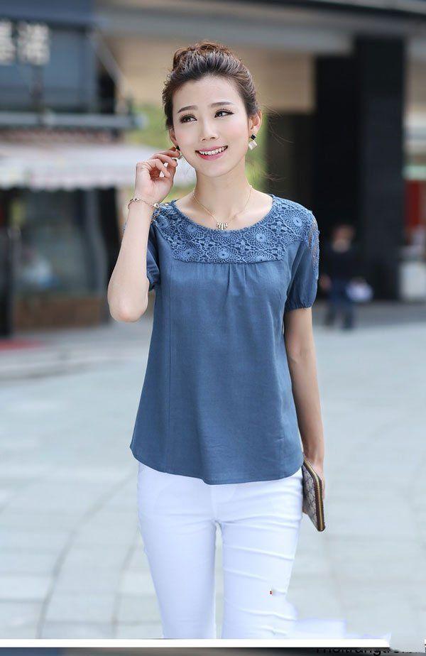 áo đầm đẹp tuổi 40 màu xanh kết hợp với quần jeans
